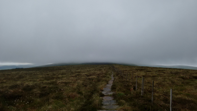 long distance path trail england moorland flagstones fog
