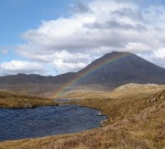 scotland highlands mountain walking rainbow
