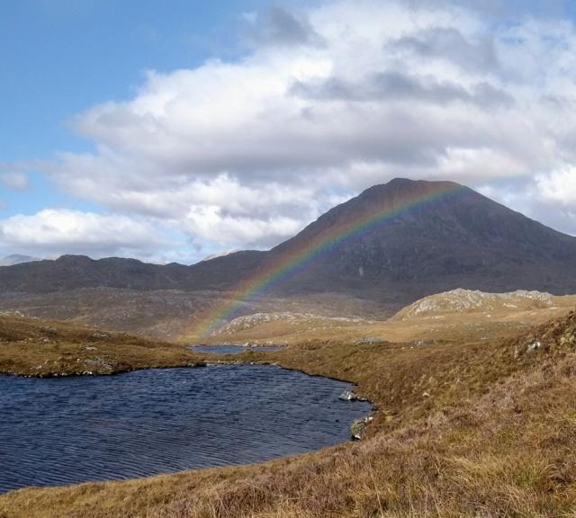 scotland highlands mountain walking rainbow