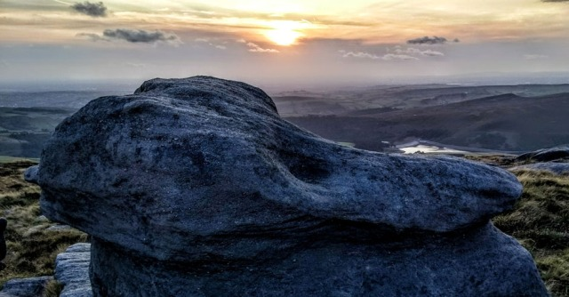 gritstone rock at sunset on kinder peak district england
